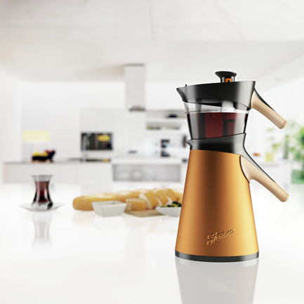 Press kit | 902-02 - Press release | A' Design Awards 2014 Winners Announced - A' Design Award and Competition - Competition - Steam <br>Tea Maker by Hakan Gürsu<br><br>PROJECT DESCRIPTION:<br>Steam is a stove-top tea maker. It brews tea by passing hot water pressurized by steam through stacked kettles. Reflecting upon tea culture in east, Steam has stacking teapots specially designed for tea preparation. Larger lower kettle is filled with water to boil, and then boiled water evaporates into upper kettle, steeping loose-leaf tea blend rather slowly. When desired amount is collected in upper part, switch on top is turned to stop water transfer. Serving is made using two kettles with poured tea and water to dilute, therefore allowing user to adjust the strength of drink. Since tea is steeped with water steam, it offers a full flavor tea brew. Showing tea color, glass teapot is complemented with glass cups. Aluminum and glass materials are used along recycled plastics; including stainless steel base all parts are fully recyclable. Harmonizing elements from traditional craft teapots and naturalist art, Steam is designed to create a modern, sculptural tea serving set. <br> - Photo credit: Hakan Gürsu, 2013