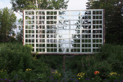 Press kit | 837-10 - Press release | The 16th International Garden Festival at Les Jardins de Métis / Reford Gardens will BUZZ in 2015! - International Garden Festival / Reford Gardens - Landscape Architecture -  A DITCH WITH A VIEW<br>by Ken Smith<br>New York, United States<br><br>Three frames spanning the ditch are constructed using recycled natural and cultural materials.&nbsp;An armature of winter fallen spruce tree trunks are fitted out with an array of recycled window sashes that simultaneously bound the secret&nbsp;garden space and provide windowed views of the ditch and the borrowed landscape beyond.<br><br>www.kensmithworkshop.com - Photo credit:  Louise Tanguay