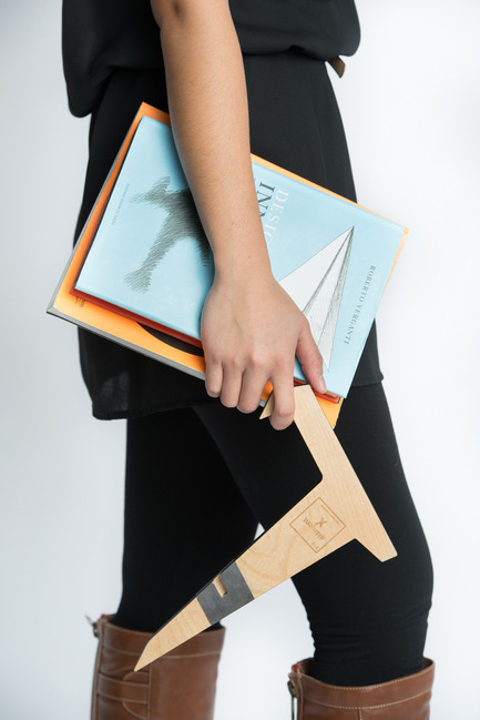 Dossier de presse | 884-04 - Communiqué de presse | HEC Project 2014 Edition - Faculté d'aménagement de l'Université de Montréal - Industrial Design -   Élément X<br><br>Two  Russian birch plywood L shapes embed themselves to form a book or  tablet stand. Two widths are possible depending on the direction of  embedding and portability is made easy by the presence of magnets. <br><br>[Recipient of the prize of the product towards a commercialization.]<br><br>Charles-Philippe Lepage<br>Thomas Ho<br>Olivier Ouimet   - Crédit photo : Olivier Ouimet 2014 - www.olivierouimet.com