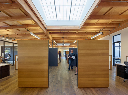 Press kit | 1733-01 - Press release | Studio VARA Adaptive Reuse Project Transforms Retail Building into New Open Office Space - Studio VARA - Commercial Architecture -         Each bullpen is lined with cork wall board on the interior. - Photo credit: Bruce Damonte