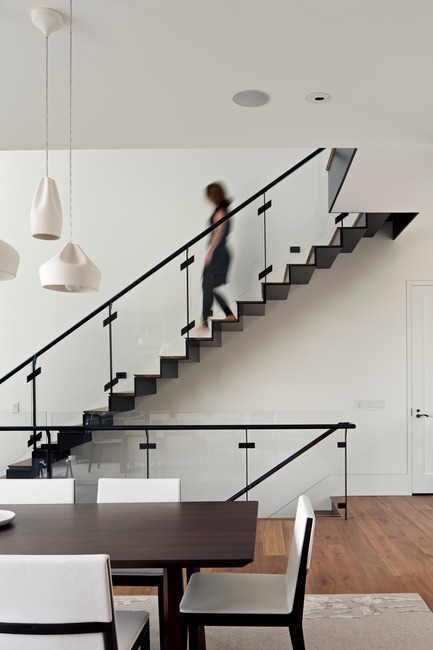 Press kit | 1733-02 - Press release | Noe Residence - Studio VARA - Residential Architecture -   The bent steel staircase cantilevers into the open foyer. - Photo credit: Bruce Damonte
