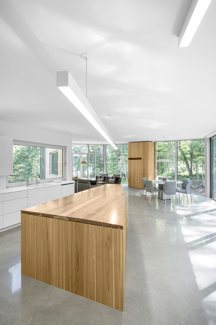 Press kit | 780-03 - Press release | House on Lac Grenier - Paul Bernier Architecte - Residential Architecture -         Kitchen island and view toward living area       - Photo credit: Adrien Williams