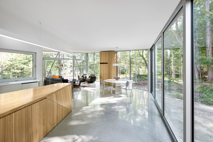 Press kit | 780-03 - Press release | House on Lac Grenier - Paul Bernier Architecte - Residential Architecture -         Kitchen island, glass wall, and view toward   living area       - Photo credit: Adrien Williams