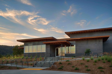 Press kit | 2039-01 - Press release | Titus Vineyards - MH Architects - Industrial Architecture -  The Southwest corner of Titus Winery is characterized by the covered hospitality area overlooking surrounding vineyards.  Exterior materials include cedar soffits, concrete board-form tilt-up walls, gunmetal blue panels above windows, and anodized aluminum window frames.   - Photo credit: Technical Imagery Studios