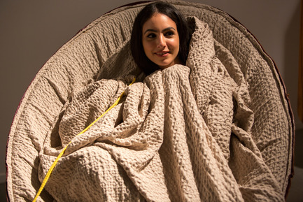 Press kit | 1604-06 - Press release | Design Days Dubai Completes It Fifth And Most Successful Edition To-Date - Design Days Dubai - Event + Exhibition - Young UAE-based fashion designer Azza Alsharif cuddles up in 'Swaddle Chair' by Fadi Sarieddine (UAE), Design Days Dubai 2016 - Photo credit: Design Days Dubai 2016