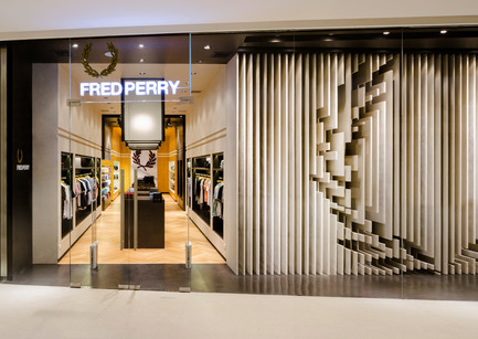Press kit | 1124-08 - Press release | WIN Awards - Retail & Workspace Interiors Shortlist Announced - World Interiors News - Commercial Interior Design - WIN Awards 2016 - Retail Interiors Less Than 200 SQM Category: Fred Perry Bangkok by BuckleyGrayYeoman (United Kingdom) <br><br>BuckleyGrayYeoman were commissioned by Fred Perry to design their latest international store within the new EM Quartier Mall, in Bangkok, Thailand. The brief was to bring the brand's iconic English identity to an already culturally rich city within a unit providing 365 sq. m of retail space.<br><br>'Fred Perry Bangkok has a very engaging shop front. It's a very confident brand experience, and perfectly lifts the product for this market.' SK <br><br>'I think this is a great design. I particularly love the sculptural facade/window. The execution is very sophisticated. The clean lines and references really help to elevate the product.' MM - Photo credit: BuckleyGrayYeoman