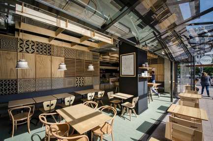 Press kit | 1124-09 - Press release | WIN Awards - Hospitality Shortlist Announced - World Interiors News - Commercial Interior Design - WIN Awards 2016 - Cafés Category:&nbsp;The Moony Café by Corvin Cristian (Romania)<br><br>The richness of details comes from a mix match of references to the culture of coffee and to the faraway lands where it comes from. Still it manages to maintain a clean, almost minimal overall image given the reduced number of textures (plywood, porcelain, black paint).&nbsp;<br><br>Ethnic patterns from Africa, Asia and South America or Arabic motifs in cut out plywood combine with especially designed lamps and insets inspired by the shape of the Austrian coffee cups and chinaware and typical Viennese café Thonet chairs.<br><br>'This one has a very interesting approach; they've taken ethnic and cultural references and put them together under a holistic banner. The laser cut panels give a very nice, restrained decorative element. The narrative is nicely layered, and on top of that, the restaurant is zoned very nicely. There are some little bits of intrigue in there that you look twice at. Altogether an unusual project that breaks the mould of many generic projects that we see.' JD<br> - Photo credit: Corvin Cristian