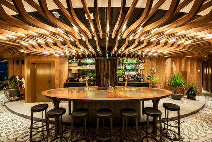 Press kit | 1124-09 - Press release | WIN Awards - Hospitality Shortlist Announced - World Interiors News - Commercial Interior Design - WIN Awards 2016 - Bars Category:&nbsp;A'DAM&amp;Co by TANK (Netherlands)&nbsp;<br><br>ADAM&amp;Co aspires to become THE members club for creative or open-minded people. The brief was to create a concept that is built around all members being part of a whole. Create a place where one can discover,&nbsp;create, make mistakes, be inspired, and make friends... Or simply grow. It should feel really unique, prestigious and special.&nbsp;<br><br>TANK has created a grand gesture that embraces all members as a whole; all their ideas, inspiration, creatures, thoughts, initiatives &amp; moods.&nbsp;There's a place for every member on every moment of the day Shaped like an overwhelming, abstracted Tree of Life that gives you shelter and refers to intimacy, grounding and play.<br><br>'The ceiling is very intelligent in terms of unifying all of the circular space and we enjoyed the sophisticated mix of textures and materials.' MA<br> - Photo credit: TANK