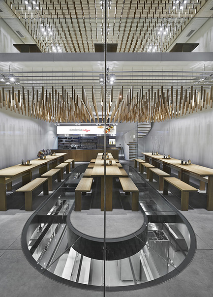 Press kit | 1124-09 - Press release | WIN Awards - Hospitality Shortlist Announced - World Interiors News - Commercial Interior Design - WIN Awards 2016 - Restaurants Category:&nbsp;Dardenia Kemerburgaz by&nbsp;Alataş Architecture &amp; Consultancy (Turkey)<br><br>The design of both space and the brand was based on keeping it simple to form a neutral background for the colorful, spicy and delicious food produced by Dardenia. &nbsp;<br><br>Working with the simplicity, the aim was to create a multi-layered, transitional in visibility, transparent space; strengthening the relationship between all zones. This was also to emphasize the well-known brand value of Dardanel by exhibiting the professionalism and the meticulousness of the kitchen as a neat-working machine in a glass box.<br><br>'We liked this from an architectural point of view. Bold structural interventions like exhibiting the kitchen in a glass box. There's a 'laboratory' like feel to it, which is both interesting and original. The limited colour palette allows the colourful food to shine. Overall, a stunning project.' GS - Photo credit: Alataş Architecture &amp; Consultancy