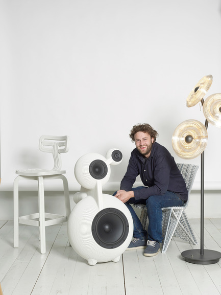 Press kit | 2158-18 - Press release | IDS Vancouver Goes Dutch on Design with Eindhoven - Interior Design Show Vancouver (IDS Vancouver) - Event + Exhibition - Dirk Vander Kooij sits on Endless Chair, next to Snowmen Speaker, Sunflower Lamp and Chubby Chair - Photo credit: Image Courtesy of Dirk Vander Kooij