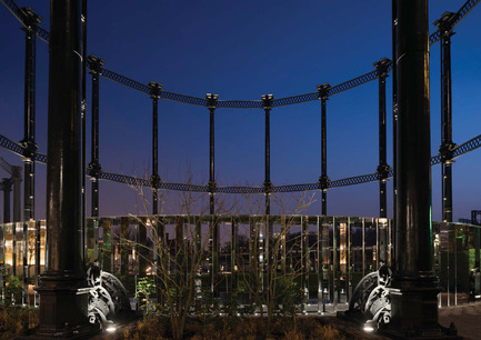 Dossier de presse | 1124-11 - Communiqué de presse | WIN Awards - Interior Practice & Lighting Categories Shortlists Announced - World Interiors News - Commercial Interior Design -  WIN Awards 2016 - Lighting Projects Category:Gasholder No 8, King's Cross by Speirs + Major (London, United Kingdom) <br><br>Located in the northern residential quarter of the King's Cross redevelopment, Gasholder No 8 is a magnificent heritage structure that has undergone a major offsite restoration. Completed in November 2015, the structure has been repurposed as the frame for a family-oriented public pocket park and event space designed by Bell Phillips Architects. The 1590 sq. m project incorporates a new mirror polished stainless steel canopy and a landscaped lawn. As appointed lighting designers, Speirs + Major were engaged to ensure that the new 'Gasholder Park' would be as attractive and feel as safe and secure by night as by day. <br><br>The lighting scheme is designed to make the most of the uniquely juxtaposing materiality and forms. Inspired by the unique circular layout, Speirs + Major conceived of creating a beautiful nighttime landmark and an enlivening immersive experience, based on the idea of a solar eclipse.<br><br>'There is a very clear aesthetic choice combined with a very strong idea which is the play of light with a very dark material. The subtle line of contour gives the shape of the gasholder almost a silhouette. It is an elegant choice and an elegant design with a sculptural quality.' FA - Crédit photo : Speirs + Major