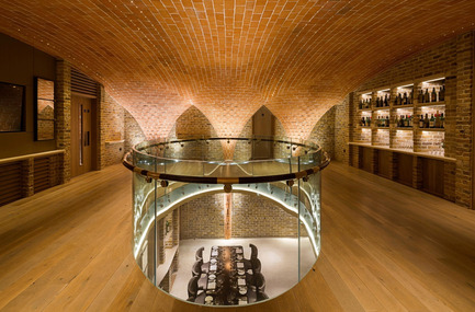 Dossier de presse | 1124-11 - Communiqué de presse | WIN Awards - Interior Practice & Lighting Categories Shortlists Announced - World Interiors News - Commercial Interior Design -   WIN Awards 2016 - Lighting Projects Category:Berry Bros - Sussex Cellar by Sutton Vane Associates (London, United Kingdom)<br><br>The Sussex Cellar is an amazing new space designed by MJP Architects for Berry Bros & Rudd, the oldest wine merchants in the country.<br><br>The amazing design by the architects has a tiled, curving vaulted ceiling over a double height space all of which is underground. A real cellar with no daylight.<br><br>The lighting has to be flexible. It has to be suitable for the famous Wine School and for dining and events of all kinds. The Wine School needs higher levels of illumination to see the colours of wines. Dining needs lower levels of intimate light and for AV presentations the screens must not be lit.<br><br>'The details are particularly nice in the scheme. Technically trying to illuminate a cellar space without the ability to recess or fix lighting can be a challenge, so they have used fiber optics in a discreet way to create a well-lit space.' OJ  - Crédit photo : Sutton Vane Associates