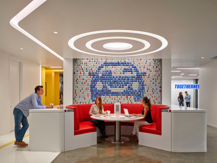 "Press kit | 2222-02 - Press release | Award winner of the 2016 International Space Design Award IDEA-TOPS for ""The Best Office Design Award"" - M+M Creative Studio - Commercial Interior Design - Edmunds - Main lounge with logo on wall (made from 2,472 small toy cars) - Photo credit: Benny Chan @Fotoworks"
