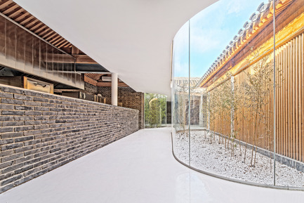 Press kit | 2264-01 - Press release | Tea House in Hutong - Arch Studio - Commercial Interior Design - Kitchen and Glass Curvy Corridor - Photo credit: Wang Ning