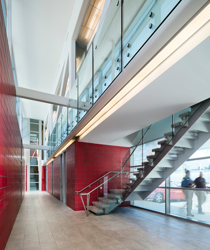 Press kit | 2322-01 - Press release | Restless Response: Emergency Medical Station 50 at Queens Hospital - Dean/Wolf Architects - Institutional Architecture - FDNY red was custom matched into materials such as the concrete block walls. - Photo credit: © Paul Warchol