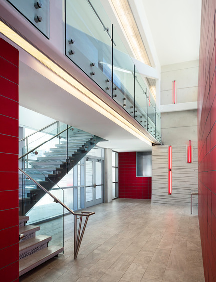 Press kit | 2322-01 - Press release | Restless Response: Emergency Medical Station 50 at Queens Hospital - Dean/Wolf Architects - Institutional Architecture - FDNY identity is reinforced throughout the circulation with red tile and fluorescent linear lighting that emulate passing ambulances. - Photo credit: © Paul Warchol