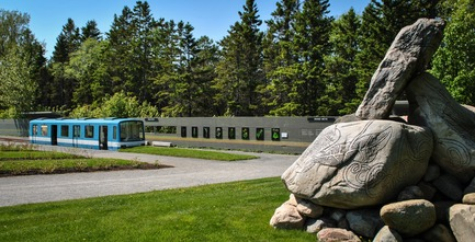 "Press kit | 837-25 - Press release | The ""Playsages"" of the 18th Edition of the International Garden Festival at Les Jardins de Métis/Reford Gardens - International Garden Festival / Reford Gardens - Landscape Architecture - Grand-Métis Station by Le Bocal d'ABCP Architecture, Quebec (Quebec) Canada. A retired Montreal Métro MR-63 wagon that has been transformed into a colourful entranceway. - Photo credit: Sylvain Legris"