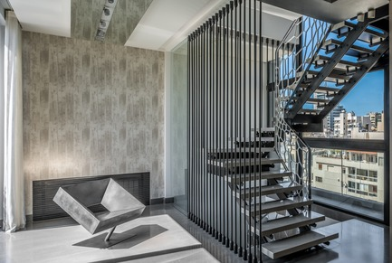 "Press kit | 2769-03 - Press release | Mallorca - Askdeco - Residential Interior Design - - ""Cadre"" noir Brutalist chair in steel with a smooth waxed finish by Stephane Ducatteau 2005 (70x76x70 cm )<br>- Stairs designed by Askdeco - inner rails are made of powder coated metal, gun metal frame and marble 2014 - Photo credit: Alex Jeffries&nbsp;"