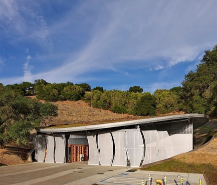 Press kit | 3089-01 - Press release | Odette Estate Winery - Signum Architecture LLP - Industrial Architecture -  Sliding perforated-metal panels in voluptuous shapes screen the covered work space at the front of the facility.   - Photo credit: Adrian Gregorutti