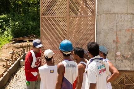 Press kit | 3162-01 - Press release | Streetlight Tagpuro - Eriksson Furunes Architecture, Leandro V. Locsin Partners & Boase - Institutional Architecture -  The fathers evaluating the prototype design of the doors they made.<br>  - Photo credit:  Alexander Eriksson Furunes
