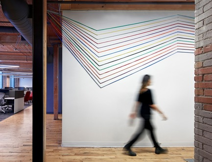 Press kit | 1513-01 - Press release | Slack Toronto Office - Dubbeldam Architecture + Design - Commercial Interior Design -  Colourful networking cables that once again reinforce Slack's brand colours are threaded throughout the workspaces, along the ceiling and across walls, as visual accents.<br>  - Photo credit: Shai Gil