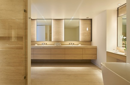 Press kit | 1733-03 - Press release | SOMA Loft Residence - Studio VARA - Residential Interior Design - The master bathroom features back-lit steel mirrors, travertine slab floors & shower walls and vanities made from wire-brushed, waxed oak - Photo credit:  Bruce Damonte
