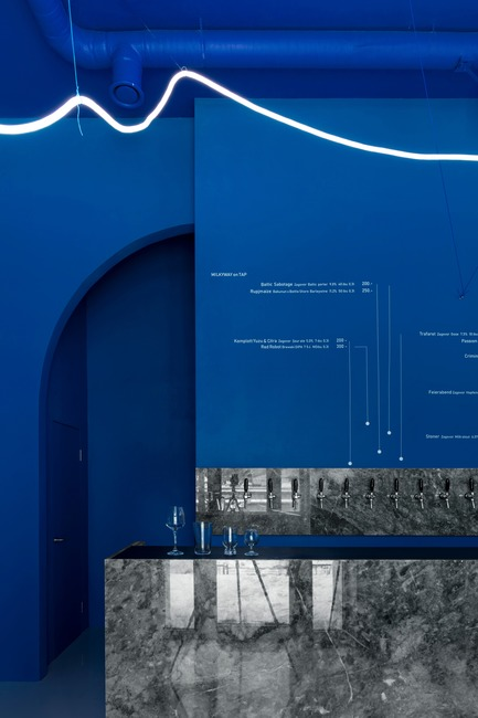 Press kit | 2247-04 - Press release | Galaxy Bar and Bottle Shop - Monoloko design - Commercial Interior Design -  Neon flex light installation with grey marble counter and 'himmelblau' blue walls  - Photo credit:  DmitryChebanenkov