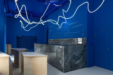 Press kit | 2247-04 - Press release | Galaxy Bar and Bottle Shop - Monoloko design - Commercial Interior Design -  Neon flex light installation with grey marble, plywood custom furniture and 'himmelblau' blue walls  - Photo credit: DmitryChebanenkov