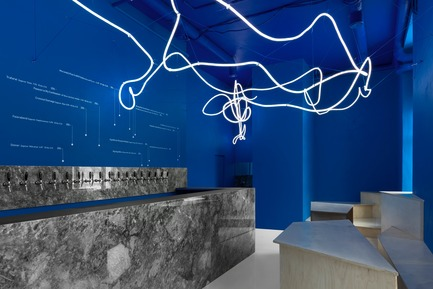 Press kit | 2247-04 - Press release | Galaxy Bar and Bottle Shop - Monoloko design - Commercial Interior Design -  Neon flex light installation with grey marble, plywood custom furniture and 'himmelblau' blue walls  - Photo credit: Dmitry Chebanenkov