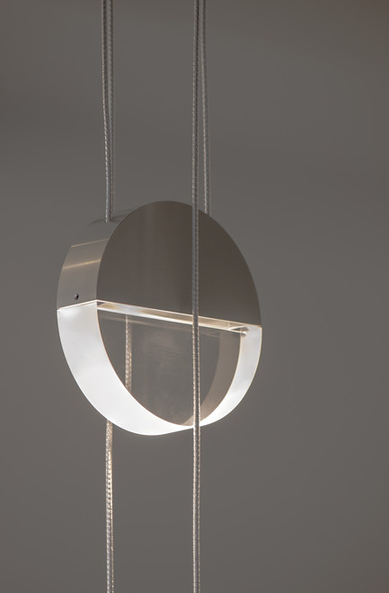Press kit | 2024-01 - Press release | Canadian Lighting Company Archilume Unveils Three New LED Luminaire Lines at  ICFF May 20-23, 2018 - Archilume - Lighting Design - Balance consists of a pair of disc shapes suspended by twinned cables, one beneath the other, hung in perpendicular directions. - Photo credit: Archilume