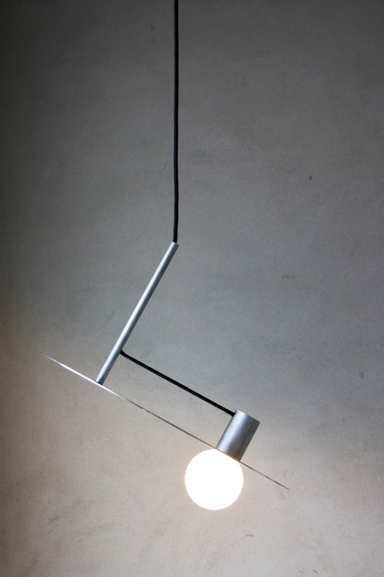 Press kit | 1895-04 - Press release | L A M P Finalists Announced for Fifth Annual International Lighting Design Competition - L A M P (Lighting Architecture Movement Project) - Lighting Design -                  L n°004 by Pierric De Coster from         Antwerp, Belgium. The pendant lamp is characterized by its simplicity and pure form. Stripped of all unnecessary, a logical composition of cylindrical shapes creates a subtle and poetic object.        The lamp only consists of three cylindrical aluminum pieces, a light source and a power cord.  - Photo credit:  L A M P
