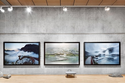 "Press kit | 3469-01 - Press release | Exhibition ""Architecture and Landscape in Norway"" - Photographs by Ken Schluchtmann - Ken Schluchtmann - diephotodesigner.de - Event + Exhibition - Exhibition view. Latex prints on Aludibond -        Trollstigen Visitor Center by Reiulf Ramstad Architects. Norwegian stones. - Photo credit:         © Ken Schluchtmann -  diephotodesigner.de"