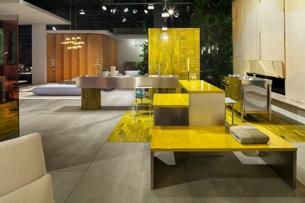 "Press kit | 2704-05 - Press release | ""Das Haus"" 2019 at the imm cologne: Living by moods creates an appetite for open-plan homes - imm cologne 2019, Koelnmesse GmbH - Residential Interior Design - The kitchen is the centre of the Active zone in ""Living by Moods"", the Das Haus installation at imm cologne 2019. Studio Truly Truly broke it down into various blocks and gave it a cheerful, stimulating character with the lime green lava stone tiles and panels (Made a Mano) that were used to construct the terraced kitchen counter. - Photo credit: Constantin Meyer; Koelnmesse"