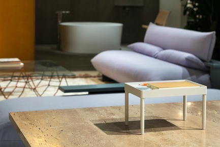 "Press kit | 2704-05 - Press release | ""Das Haus"" 2019 at the imm cologne: Living by moods creates an appetite for open-plan homes - imm cologne 2019, Koelnmesse GmbH - Residential Interior Design - A view across the travertine tabletop (e15) from the Active zone into the Serene area of ""Living by Moods"", the Das Haus installation at imm cologne 2019. The Press sofa is a prototype by guests of honour Studio Truly Truly, executed in ash and covered with Kvadrat's Vidar fabric. - Photo credit: Constantin Meyer; Koelnmesse"