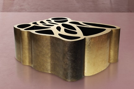 Press kit | 3917-03 - Press release | FORMITABLE©Collection - Wael Farran Studio - Product -   MAZE -                COFFEE TABLE <br>              Laser cut multilayer MDF wood assembled to give a sculptural table treated with gold leaf on a black base with a degradation patina on sides and 2 cm clear crystal glass.<br>               PIECE DIMENSIONS: 110/81/93cm H: 45cm<br>   - Photo credit:                GENIA MAALOUF