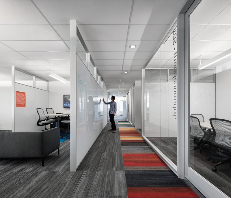 Press kit | 3143-02 - Press release | Genetec Spaces in Montreal: When Design Impacts Processes and Productivity - FOR. design planning - Commercial Interior Design - Each Innovation Circle includes a Microsoft Surface Hub. Employees are able to write on 100% of the walls, made of whiteboards and glass - Photo credit: Stéphane Brugger