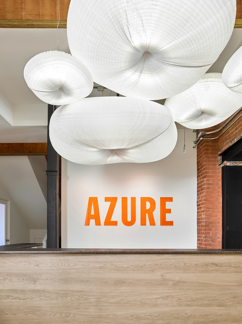 Press kit | 1513-05 - Press release | Azure Publishing Office - Dubbeldam Architecture + Design - Commercial Interior Design - In keeping with the Canadian designers who are routinely featured in the magazine, the whimsical pendant overhead is by Molo, a Vancouver-based studio that makes furniture and lighting fixtures out of expandable paper geometries. - Photo credit: Scott Norsworthy