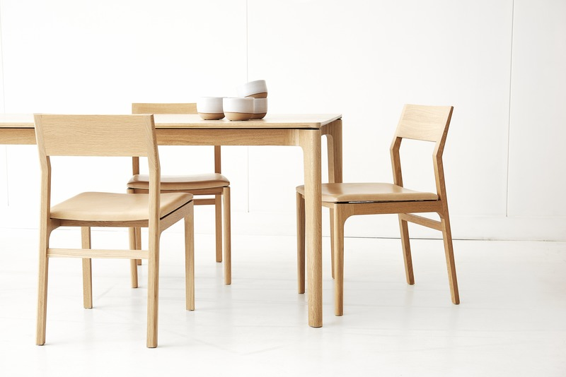 Press kit | 1077-07 - Press release | Creative form meets functionality with the Cove Collection by Kastella - Kastella - Product - T113 table & C205 chairs shown in American White Oak - Photo credit: Adam Stein