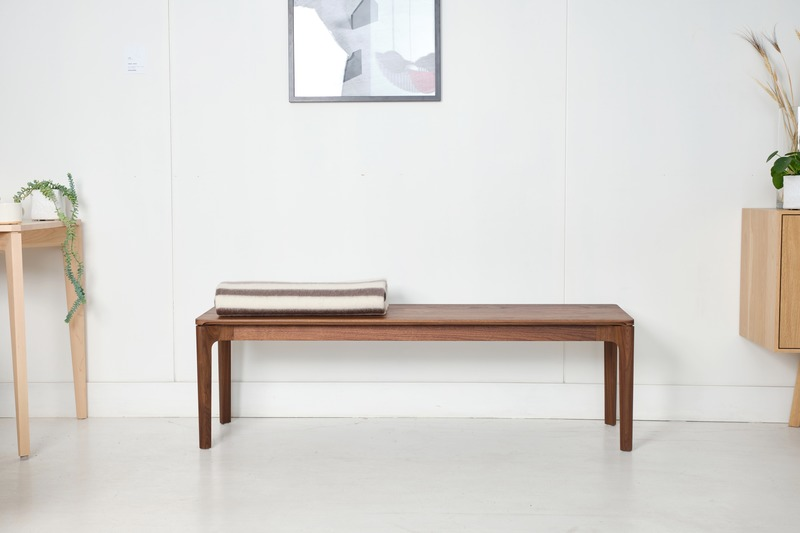 Press kit | 1077-07 - Press release | Creative form meets functionality with the Cove Collection by Kastella - Kastella - Product - C112 bench shown in American Black Walnut - Photo credit: Adam Stein